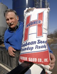 Photo by Skip Lawrence - Gareth Harshman displays a bag of Roundup Ready soybean seeds at his farm near New Market.